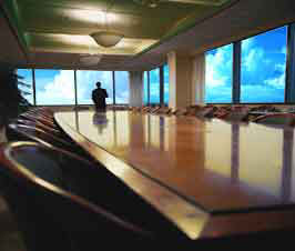 a large empty office conference room with a view of the sky